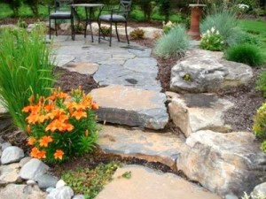 Flagstone patio and steps with orange flowers