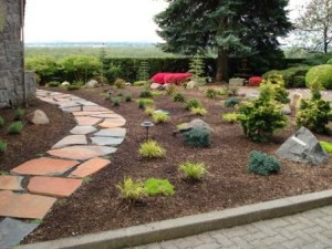 flagstone path, landscaped bed with lighting