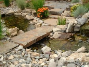 Frontier Landscaping water feature: flagstone steps and bridge