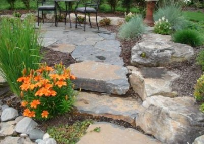 Frontier Landscaping stone stairs and retaining wall.