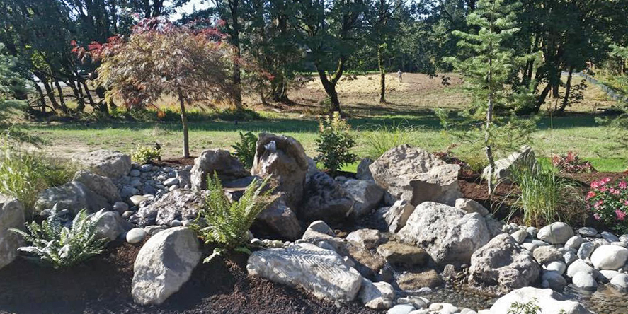 miles-parade-of-homes-2016-water-feature-ornamental plantings