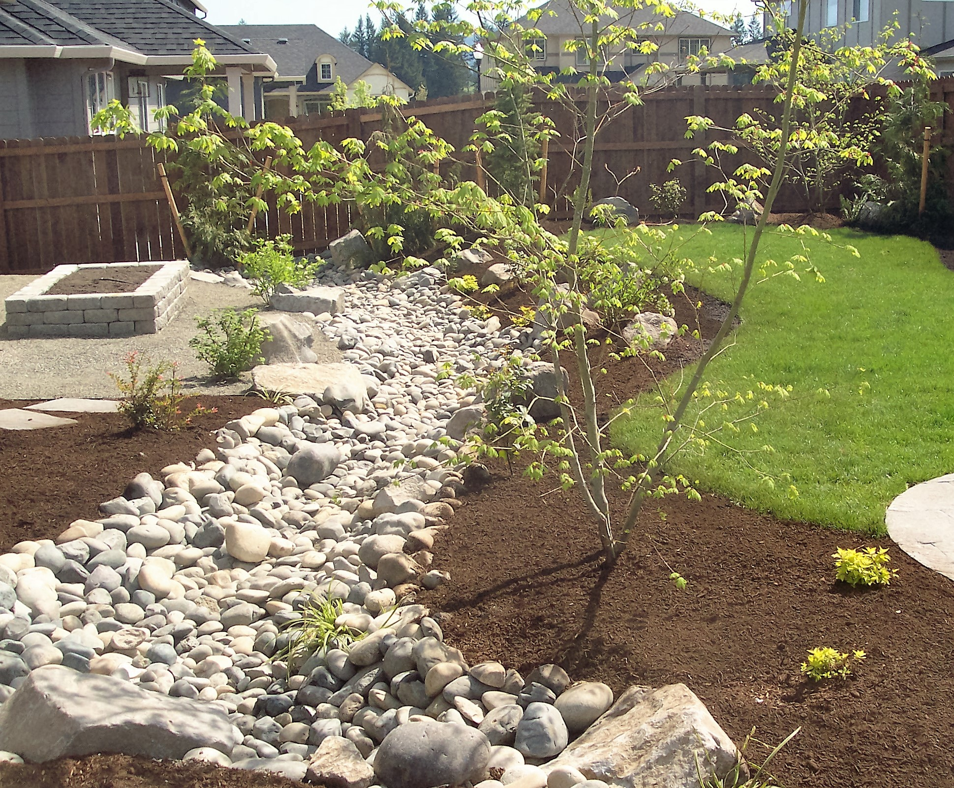 Solving Water Problems With Dry Creek Beds Frontier Landscaping