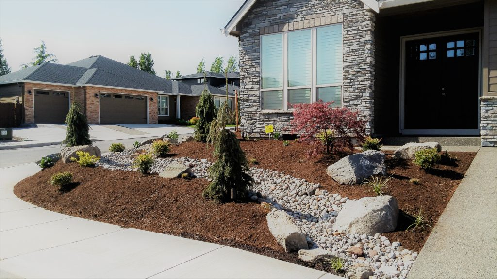 curb appeal residential-installation-dry-creek-bed-accent-rockery-boulders-plantings-bark
